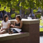 Willamette University students sit together on campus