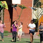 Agnes Scott College students fly kites on campus