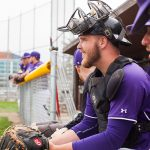 Knox College baseball players sit in the dugout