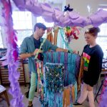McDaniel College students work on an art project together