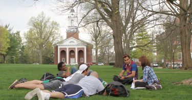 Wabash College students hang out on the campus lawn