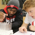 Wabash College students work together in a science lab