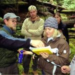 Evergreen State students and professors work together in a forest