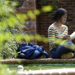 A Hiram College student studies outside