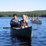 Marlboro College students canoe on a lake