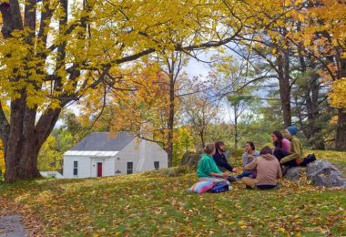Marlboro College students study together on the lawn on an autumn day