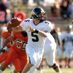 The McDaniel College football quarterback throws a pass in a game