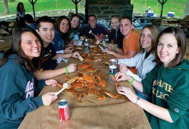 McDaniel College students enjoy a crab boil together