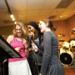 A trio of McDaniel College students sing together