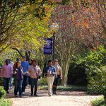 Millsaps College students walk to class together on a fall day