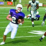 A Millsaps College football player runs with the ball in a game