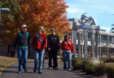 Ohio Wesleyan University students walk to class on an autumn day