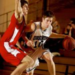 Ursinus College varsity basketball player makes a break on the court