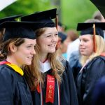 Ursinus College students smile for graduation photos