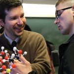 A Wabash College students and professor discuss moleculer structures