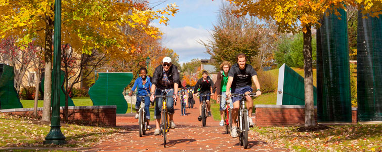 Allegheny College students ride bikes across campus