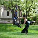 Beloit College student performs a dance on the campus lawn