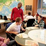 Denison University professor talks with students in a classroom