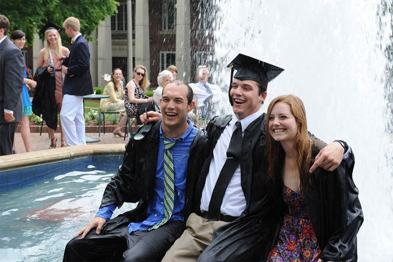 Three Birmingham-Southern College students pose for pictures after graduation