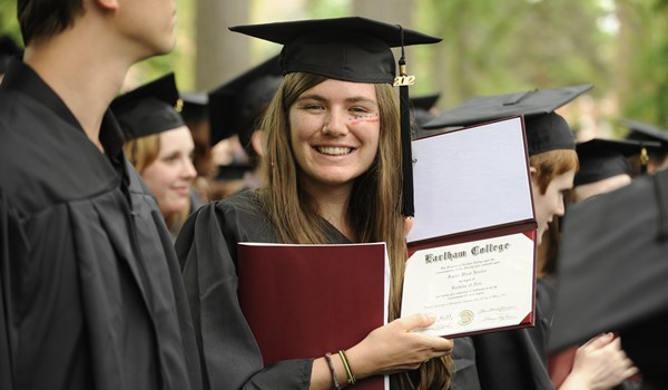Earlham College graudate holds her diploma