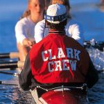 Clark University crew team competes on a river