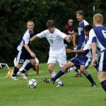 Earlham College varsity soccer team plays in a match