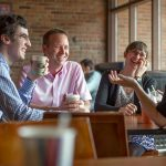 Earlham College students and professors meet over coffee