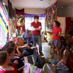 Hendrix students visit together in a residence hall room.