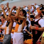 Hendrix College students cheer at a basketball game