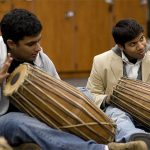 Kalamazoo College students play drums together