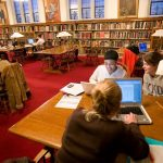 Knox College students work together in the library