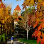 Whitman College students walk across campus on an autumn day