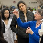 Whitman College students work with their professor in a science lab