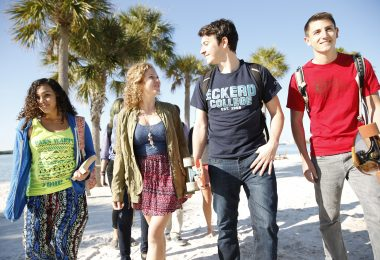 Eckerd College students walk to class on a sunny day