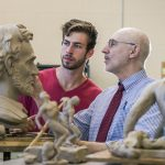 Hillsdale College students and faculty work together on a sculpture