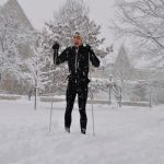 A St. Olaf student skis across campus